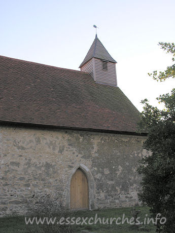 All Saints, Vange Church - The North door, with very tidy belfry sitting atop the church.
