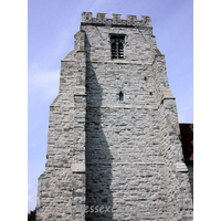 St Nicholas, Canewdon Church - This tower is of grey dressed ragstone. It has four stages, with angle buttresses, and battlements a stone and flint chequered pattern.