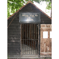 St Nicholas, Canewdon Church - The village lock-up and stocks.