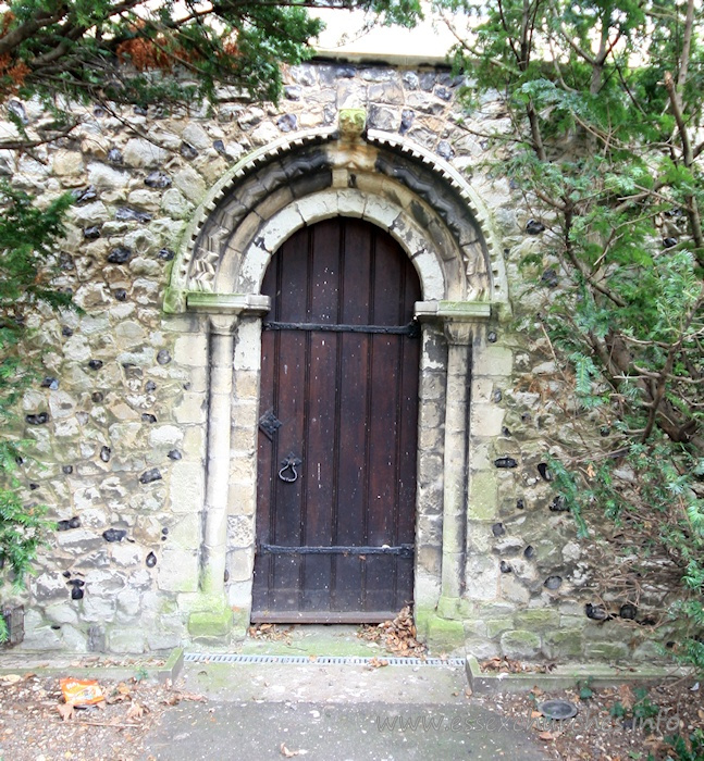 Holy Trinity, Southchurch Church - This is the original Norman north door, relocated to become the west door of the new nave, after Comper's enlargements in 1906.