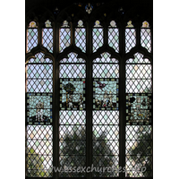 St John the Baptist, Thaxted Church - This stained glass window (and the following four enlargements of the panels within it) depicts Adam and Eve. The original glass in the panels dates from C15.