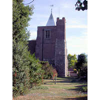St Giles & All Saints, Orsett Church - The W tower occupies the westernmost bay of the N aisle. It is partly stone, and partly C17 brick. It has a large diagonal buttresses, and as can be seen in this picture, a bulky NW stair-turret. At the top it sports a white weather-boarded spire.