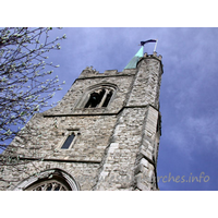 St Andrew, Hornchurch Church - This view directly up the W front of the tower shows the sheer height of the spire and tower combined. Note the small bell across the top window.