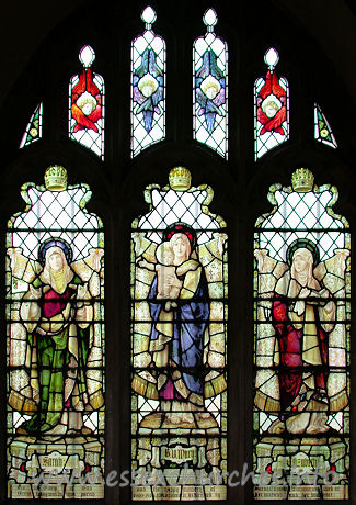 St Andrew, Hornchurch Church - This second, north aisle window is early 20th century, and is a memorial to Sarah Williams who lived at Great Langtons. It depicts St Sarah, The Virgin Mary and St Elizabeth and it was designed and made by Haydon Bacon of London.