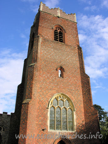 St Michael, Thorpe Le Soken Church - Note the two-light bell-openings, with the single circle as tracery. This is all executed in brick!