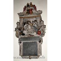 St Edmund, Abbess Roding Church - Monument to Lady Luckyln d.1633, consisting of a frontal demi-figure, with the head resting on one elbow, with a book in the foreground. Behind, two cherubs hold open a curtain. The monument has been attributed to Epiphanius Evesham, by J. Seymour.