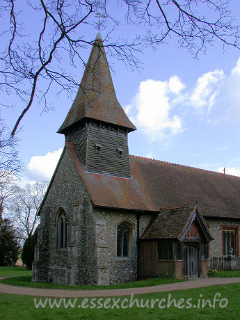 St Mary, Broxted Church - The belfry is weatherboarded, and stands on four posts.