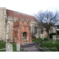 Holy Trinity, Rayleigh Church -    This brick porch conceals a C13 South doorway. The porch  itself has two-light brick side windows, and is crowned with stepped battlements  upon a trefoil-arched corbel frieze.