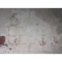 St Mary, Mundon Church - This is the earliest scheme of wall painting, and has recently been identified as the Martyrdom of St Edmund, King of East Anglia by Professor David Park, Courtauld Institute of Art, Conservation of Wall Paintings Department. He is crowned and the Danes are shooting arrows at him from in front and behind. === Only the head and shoulders of the Edmund figure, in three-quarter profile, remain, outlined in red, with his hair painted red and his eyes painted black. Behind the saint are vestiges of a bow, hand and arrow: the bow outlined in black; the arrow and hand in red. Facing him are the remains of two hooded figures in profile, the nearest is shooting another arrow: this and the figures are outlined in black; their hoods are red. === Above the Edmund figure is an unidentifiable figure outlined in black.