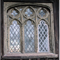 All Saints, Stock Harvard Church - Three-light traceried wooden window.