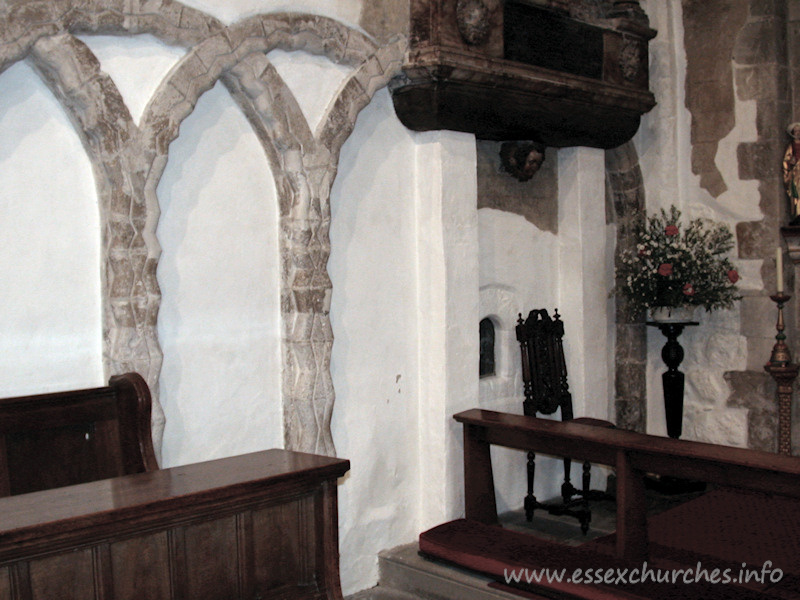 St Mary Magdalene, East Ham Church - The north nave wall. Note the glazed aperture to the left of 