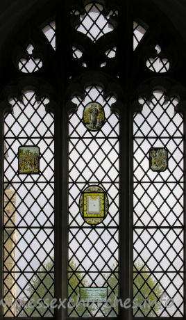 St Nicholas, Elmdon Church - The 17th century painted glass in this window was removed from St Dunstan's Church, Wenden Lofts, during demolition of that church. A.D. 1958.