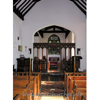 All Saints, Nazeing Church - The chancel arch, with screen. The two strange objects to either side of the arch are the remains of the rood screen supporting structure. Higher, and to the left, can be seen the remains of the rood beam.
