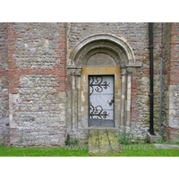 St Michael & All Angels, Copford Church - The N doorway into the nave is Norman. It has two orders of columns with primitive capitals, and two roll mouldings in the arch.