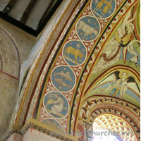 St Michael & All Angels, Copford Church - The left-most part of the underneath of the chancel arch, which depicts all 12 signs of the zodiac.From bottom to top can be seen: Aquarius, Pisces, Aries and Taurus.